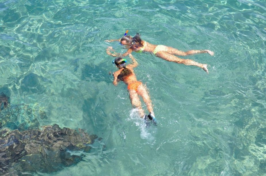 two girls snorkeling without fins
