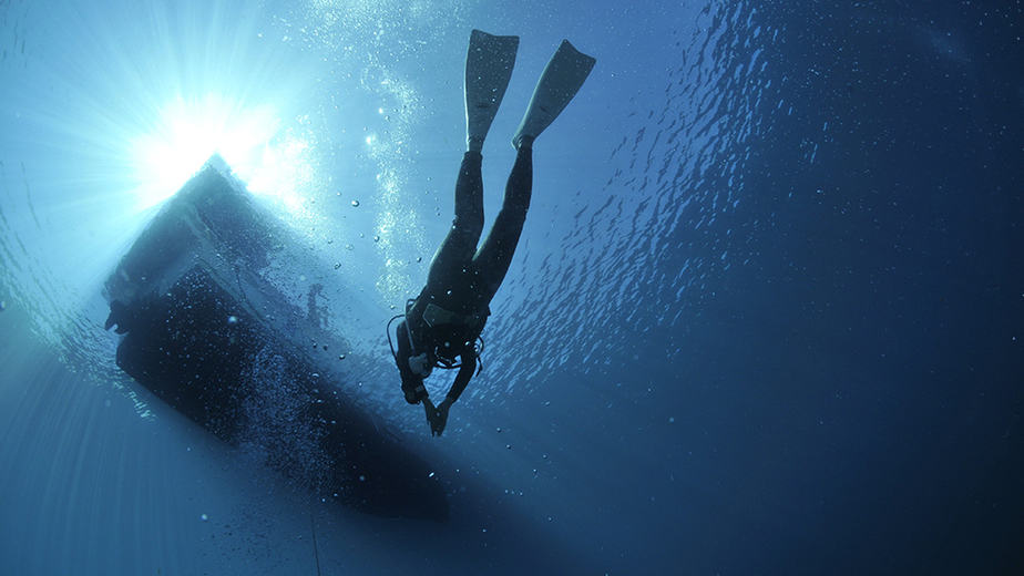 freediving by a boat